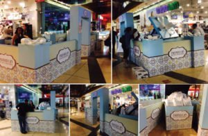 Booth design for mall. A compound with a huge gift box with sales person and customer service area