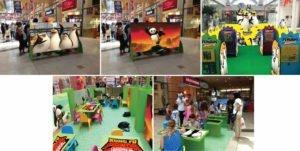 אילוסטרציה הדמיה למתחם משחקים של דרימוורקס עם קונגפו פנדה, הפינגואינים ממדגסקר וילדים משחקים