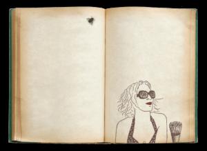יומן פתוח עם תמונה של מיס הילה עיצוב גרפי וזבוב מונח לעיו, כאילו שנמצא על המסך